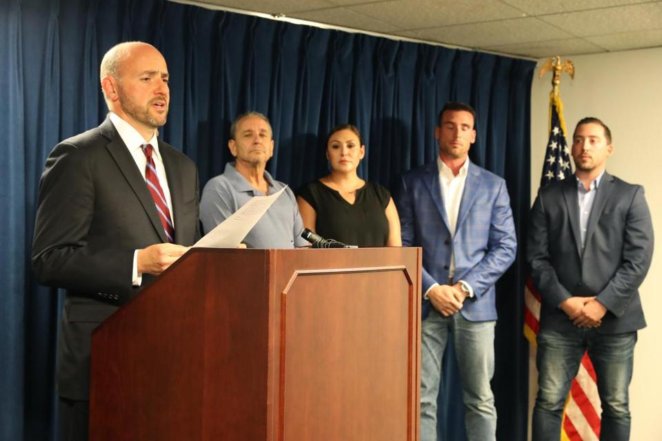 "BUS Attorney Andy Lelling read a statement from the victim""s family, (l-r) Roland Wheeler, Colby DiSarro, Nicholas DiSarro, and Michael DiSarro."